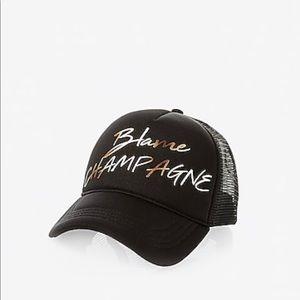 Express blame champagne trucker hat